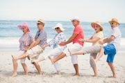 Diabetic senior friends dancing on the beach