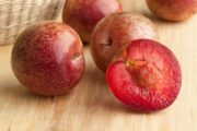 Fresh pluots on wooden counter are healthy foods you should try