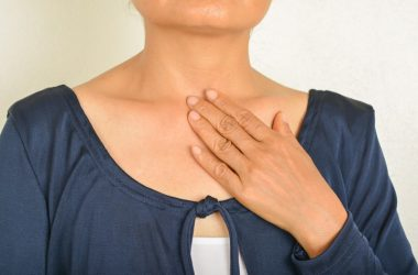 Close up of woman with hand on chest needs heartburn relief