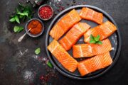 Fresh salmon fillets on a plate are a good example of healthy fatty fish to fight diabetes and more