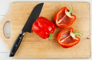 Red bell pepper on cutting board part of healthy snacks to try