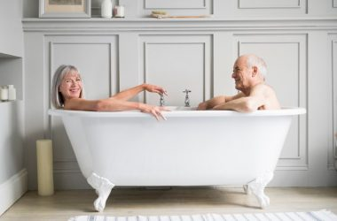Senior couple in hot bath together smiling