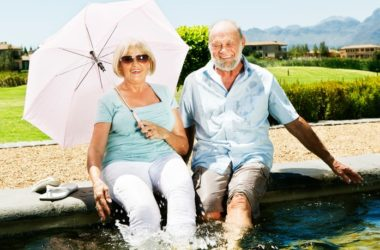 Smiling senior couple splashing in fountain of youth will live longer