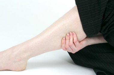 Woman holding sore calf muscle caused by DVT