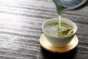Close up of tea being poured to illustrate green tea health benefits like cancer fighting