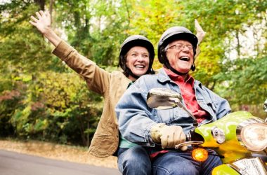 Happy senior couple on scooter live longer because of attitude