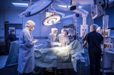 Operating room scene with patient under anesthesia