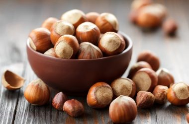 Bowl of healthy hazelnuts on a table