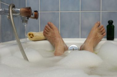 Feet of man soaking in a soothing hot bath battling heart disease and more