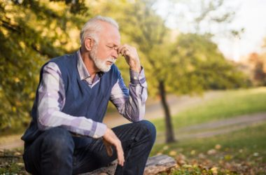 Senior man with weak muscles sits down to rest