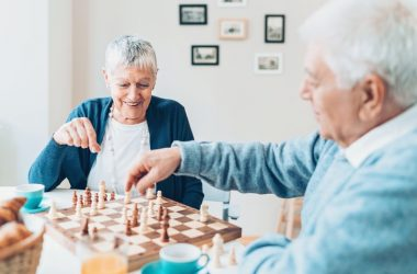 Happy senior couple playing chess has no cognitive decline or Alzheimer's