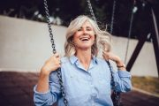 Mature energetic woman on a swing takes DHEA therapy