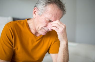 Senior man in pain from sinus infections