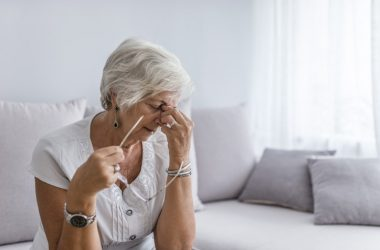 Senior woman suffering from cancer treatment side effects