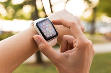 A woman adjusts her smartwatch which could be used to invade privacy
