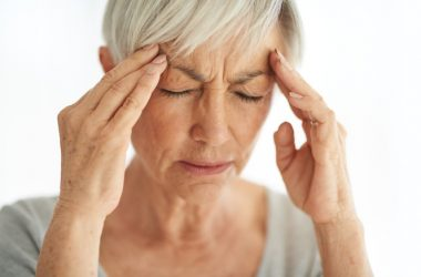 Senior woman suffering with migraine pain migraines