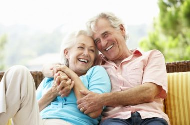 Smiling senior couple lost weight before summer