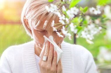 sneezing woman needs relief from spring allergies