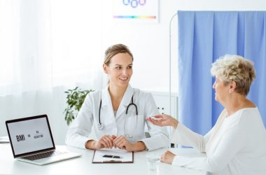 Overweight senior talking to doctor about bariatric surgery