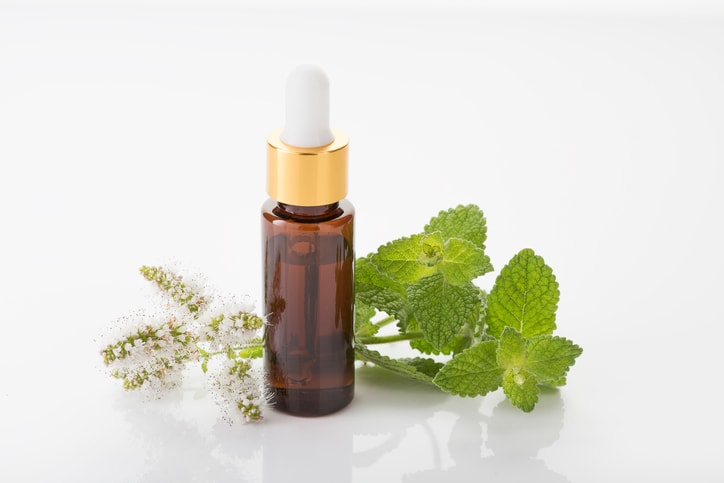 Peppermint oil and sprig of fresh mint can help with swallowing