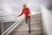 Senior woman falls down steps to illustrate polypharmacy dangers
