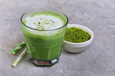 Green matcha tea in glass and powder in white bowl for anxiety