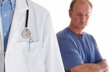 Man at follow up doctor's visit for prostate cancer