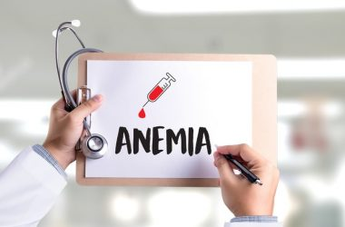 illustration anemia written on paper with blood draw needle
