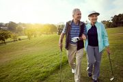 Senior couple playing golf to build muscle & reduce heart risk