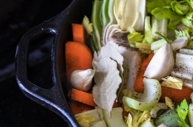 Close up of stock pot with breast cancer fighting garlic and onions and other veggies