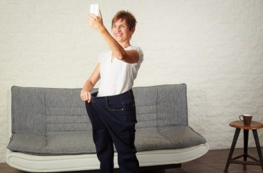 Senior woman in diabetes remission taking selfie of weight loss