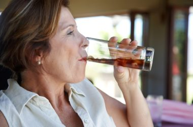 Attractive mature woman drinking diet soda linked to weight gain and more