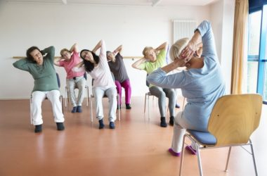 Seniors doing chair yoga to help reduce brain shrink