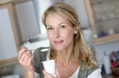 Woman eating yogurt to reduce her breast cancer risk