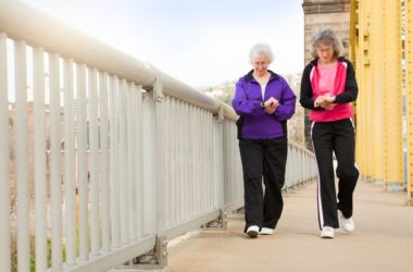 Two senior women counting steps for weight loss