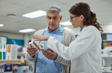 Pharmacist reviews medications prescribed after hospital discharge