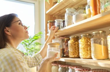 Woman restocking her pantry to prepare for a second wave of coronavirus