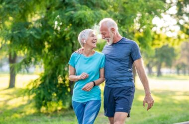 Active senior couple enjoying the park without battling muscle aches and weakness