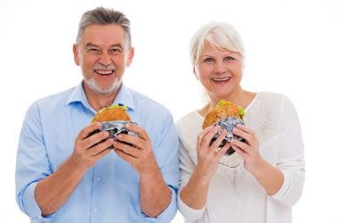 Senior couple eating fast food hamburgers laced with PFAS chemicals