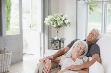 Senior couple napping on couch sleep hack