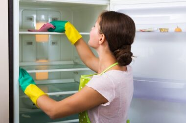 Woman cleaning out the fridge for a workout instead of exercise