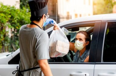 Woman picking up her curbside carryout food