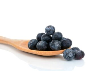 Fresh blueberries on a wooden spoon could help ease IBD