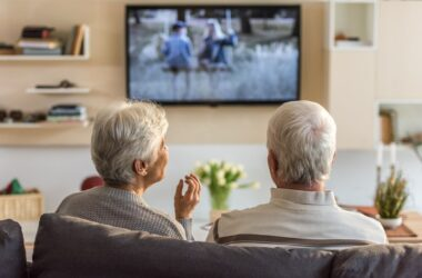 Senior couple watching TV can help heart health by moving during ads
