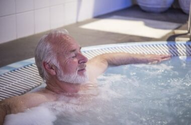 Senior man relaxing in hot tub with his eyes closed fighting diabetes