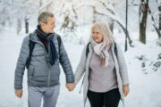 Seniors taking a snowy winter walk protected by immune supporting ElderWell