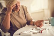 Woman in pain about to take a painkiller is in danger of opioid addiction
