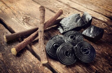 licorice, roots, pure blocks and candy on a wood background