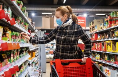 Woman buying grocery in supermarket during Covid-19 pandemic