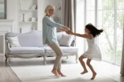 Energetic youthful grandmother dancing with granddaughter uses Cell Thrive